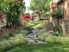 Chateau De Fleurs: Cindy Browns Amazing Storybook Cottage in Northern Ca. is Exploding with Flowers! Please enjoy the photos she just sent, its like straight out of a fairytale book. XO Christie
