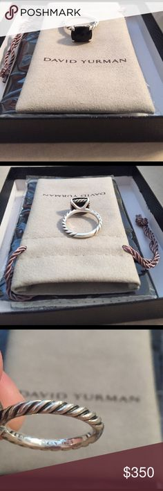 David Yurman Black Onyx Ring Gently worn ring in excellent condition! Ring was bought at Bailey's so it has the Bailey Box it came in as well as the David Yurman bag and the David Yurman cloth to clean it unopened! Ring has never been resized so it should be a size 7. David Yurman Jewelry Rings