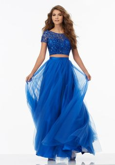 Prom Dresses by Morilee designed by Madeline Gardner. Two-Piece Prom Dress with Soft Tulle Skirt and Fully Beaded Net Top. Cap Sleeves.