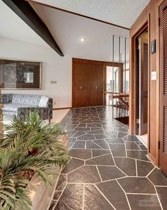 mid century modern home with asymmetric slate floor in the foyer