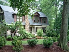 Front+Yard+Courtyard+Designs | Tudor home with old and new plants