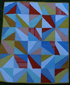 "baby quilt, handmade, 33""x40"", orange and blue, modern quilt. $80.00, via Etsy."