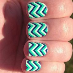 Chevron blue, white and green nails.