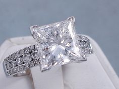 This is our exceptional 4.05 ctw Princess Cut Diamond Engagement Ring. It has a splendid 3.50 carats Princess Cut Center Diamond that is D Color/VS2 Clarity, Clarity Enhanced (Fracture Filled and Laser Drilled) Center Diamond. It is captivating and set as a solitaire with 0.55 cts of accent diamonds set in three rows on the band made of 14K White Gold. It is listed for $39,990. Diamond Girl, Black Diamond, Diamond Rings, Diamond Engagement Rings, Princess Cut Diamonds, Vintage Diamond, Modern Jewelry, Diamond Shapes, Beautiful Rings