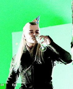"""during the filming of the scene where Legolas is suppose to catch Tauriel talking to Kili there was a surprise improvisation by Orlando when the camera panned over to show him on the balcony. he wears a party hat and drinks champagne then swallows and yells """"Slut!"""" to Eve (tauriel) the whole crew started laughing because they weren't expecting it. <--- LOL SO HILARIOUS"""