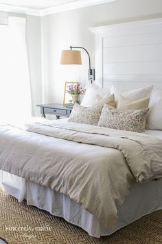 modern farmhouse bedroom design with all white bedding and simple curtains, cottage bedroom design with jute rug, neutral master bedroom decor ideas, shabby chic bedroom Farmhouse Planked Headboard - Sincerely, Marie Designs Easy Home Decor, Home Decor Bedroom, Bedroom Furniture, Home Furniture, Bedroom Ideas, Design Bedroom, Luxury Furniture, Furniture Design, Furniture Stores