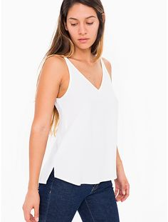Crepe camisole with deep V-neck and back, skinny straps and loose fit.