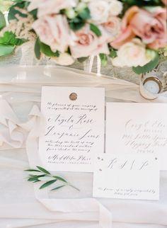 Elegant Calligraphy Invitation with a Custom Wax Seal | Vasia Photography | https://heyweddinglady.com/modern-war-and-peace-wedding-inspiration-blue-silver/