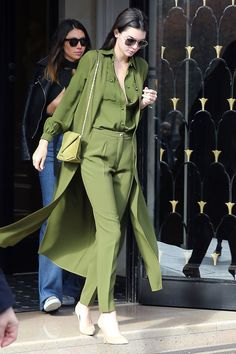Leaving her hotel in Paris, Kendall goes monochrome in an olive green ensemble by Elie Saab with a matching bag and neutral pumps.