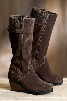 Italian cowhide suede provides waterproof protection in these tall wedge boots. Free shipping + returns.