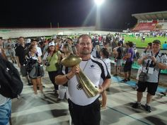 Dr. Mark poses with the National Championship Trophy after his work with the Pro Football team.