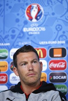 Captain, Stephan Lichtsteiner of Switzerland talks to the media during the Switzerland Press Conference at the Stade Bollaert-Delelis on June 10, 2016 in Lens, France.