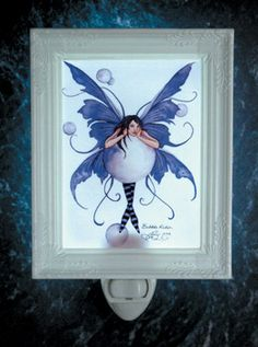"""Bubble Rider Night Light by Amy Brown, a magical way to add light to any room. Features a cute smiling fairy riding a bubble. This fairy night light will bring the imagination out just before bedtime and help fall asleep with happy thoughts.  Dimensions: 3 1/2"""" W x 4 1/2"""" H Price: $21.95"""