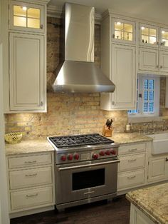 LIKE THIS LOOK  MAYBE THE BEST... Kitchen with Brick backsplash | Dresner Design traditional-kitchen