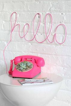 wall decor ideas for living room pink telephone with pink neon hello sign