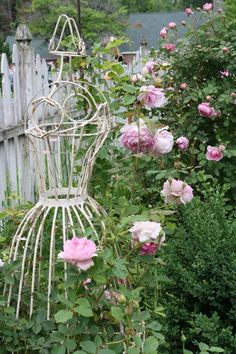 roses and dress form art in the garden