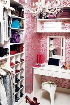 Walk-in closet...super cute wallpaper & chandelier