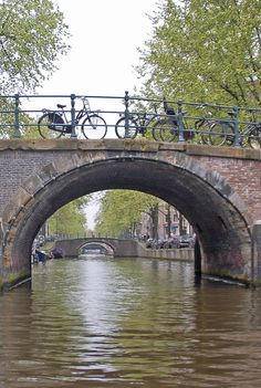 Nothing says Amersterdam in the Netherlands more than bicycles and bridges! Everywhere you go in Amersterdma there are many many more bicycles