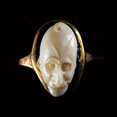 Roman Gold Agate Cameo with a frontal head of a grotesque                                                                                                                                                        Culture :                  Roman, Roman Imperial                                              Period : 1st-2nd Century A.D.                                          Material : Agate and Gold