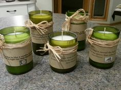 Candles in cut wine bottles