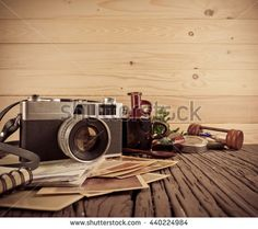 image of Retro camera and vary of decoration on wood table background(vintage color tone)