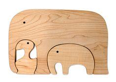 joel little wooden puzzle  http://madebyjoel.com/