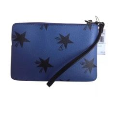 Coach Star Canyon Corner Zip Wristlet NWT Coach Star Canyon Corner Zip Wristlet Special Edition Blue Black F64239 retails for $75. Perfect condition Coach Bags Clutches & Wristlets