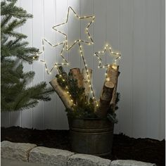 Light up the night with our festive set of LED-illuminated pathlight stars. Features a trio of plug-in stake lights, each connected by a clear, wire, allowing for decorative flexibility. Line a walk way or group with other seasonal decor for a tou