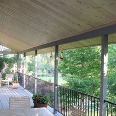 covered backyard deck overlooking yard