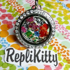 80s girls unite! Check out this custom Rainbow Brite locket! Set to a background of TV static, these bright charms turn heads! Wear your collection, and show off at a convention! Can be customized however you like with any collection! Available by request at www.replikitty.etsy.com #rainbowbrite #rainbow #bright #neon #color #pop #crystal #bling #locket #jewelry #origamiowl #charms #locketideas #lockets #gifts #birthday #rainbowbriteparty #birthday #rainbowbirthday #giftbag #treatbag…