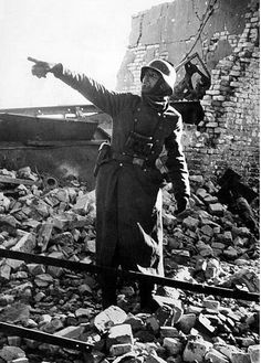 "panzerknacker88: ""Among the rubble of the industrial area a German officer showing the station from which the Soviets keep shooting. Stalingrad, November 1942 """