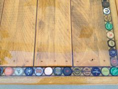 Bottle cap table made with recycled wood