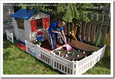 I love how this outdoor playhouse comes alive with the garden attached and artificial flowers.