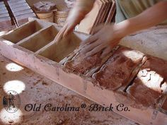 How we make them - throwing mud by hand into sanded wood mold.  www.handmadebrick.com