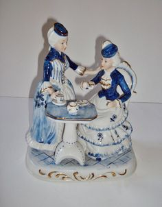 Vintage Porcelain Figurine Victorian Ladies Having Tea Blue and White. $42.00, via Etsy.