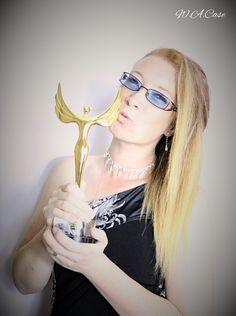 cheeky kiss on the film festival award.