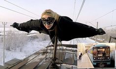 Meet Batgirl, the daredevil teen who 'flies' on the tops of trains during Moscow's rush-hour
