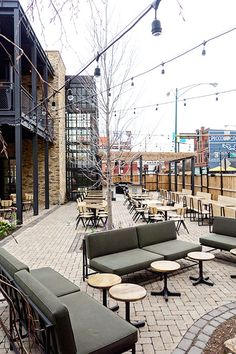 The Dawson's gorgeous new patio beckons. With seating for 150, the slick, contemporary space features a fireplace, communal seating, a beautiful metal bar, and a host of chic design touches, including an array of striking flowers and plants.