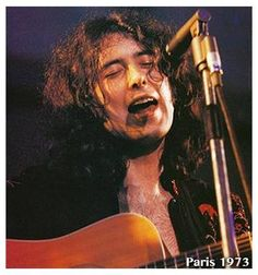 Jimmy Page....singing!! He's actually got a good singing voice, listen to 'She Just Satisfies'