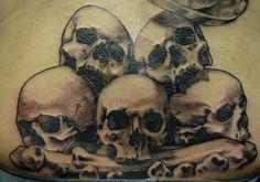 Damon Conklin, Super Genius Tattoo, Seattle WA, black and white tattoo, pile of skulls