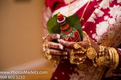 Bengali wedding details in a mixed interfaith wedding in Teaneck Marriott, NJ. Bengali Wedding Ceremony rituals. Bridal Make up by Shital. Mandap by Abhishek Decorators. Interfaith Wedding by PhotosMadeEz.Best Wedding Photographer Photosmadeez.