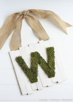 Dollar Store Carries 12X12 Astro Turf (fake grass). These would be cute to make for Easter or even Hostess Gifts! DIY: Monogram Moss Pallet Sign...great tutorial. She uses shims not boards, so this would be perfect for the front door!