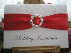R0019e White Lace Red Wedding Invitation Pearl Diamante Buckle Available from www.vintagelaceweddingcards.co.uk