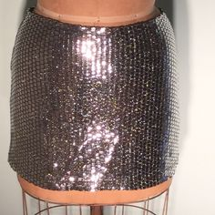 """XOXO Jeans silver shimmer micromini skirt Wear a disco ball! No it's a micromini. Square silver shimmers over a woven black jersey. Black jersey lining, back zip. About 13.5"""" long on hem, WOW! Size 3. 100% poly. MADE IN THE U.S.A. PM#176 XOXO Skirts Mini"""