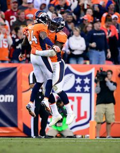 Denver Broncos outside linebacker Von Miller #58 celebrates with Denver Broncos cornerback Champ Bailey #24 in the end zone after scoring a touchdown in the third quarter. Broncos vs. Buccaneers 12-2-2012.