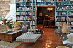 This is the studio loft of two of my favorite crafty minds, Stephen and Shauna of 'Something's Hiding in Here'. I love the juxtaposition of the bright space and darker room beyond the bookcase.