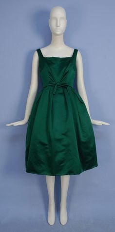 CHRISTIAN DIOR SILK DRESS and JACKET SET, 1950's. Sleeveless emerald green satin with square neckline, fitted bodice with self bow at waist, full skirt with large pleats over crinoline, matching short sleeve jacket with shawl collar. New York label. Front 1