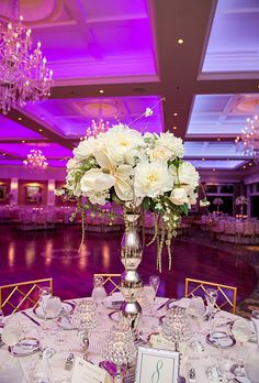 Tall, white wedding reception flower centerpiece (Laura Leigh Photo)