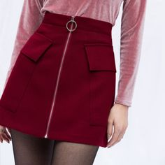 This is a charming mini skirt that will soon be a staple in your closet! It comes with a flattering high waistline, a front zipper closure with a circle pull ring, two roomy flap pockets, an A-line silhouette, and a mid-thigh length. This would work well Korean Fashion Casual, Korean Fashion Trends, Skirts With Pockets, Mini Skirts, Cute Skirts, A Line Mini Skirt, Dungaree Dress, Thanksgiving Outfit, Prom Dresses Online