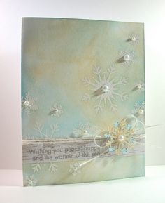 white embossed them and used Antique Linen and Broken China Distress Inks for a resist look.